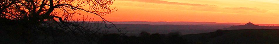 Sunset over Glastonbury tour & Glastonbury festival Site Somerset. The home of Apple Vintage